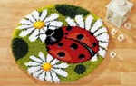 Tapis point noué La coccinelle