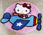 Tapis point noué hello kitty est pilote